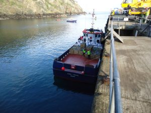 granite-blocks-being-delivered-to-sark-island-by-boat