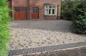 silver-grey-yellow-gold-&-black-natural-split-granite-driveway