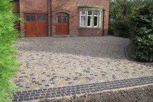 silver-grey-yellow-gold-&-black-natural-split-granite-driveway